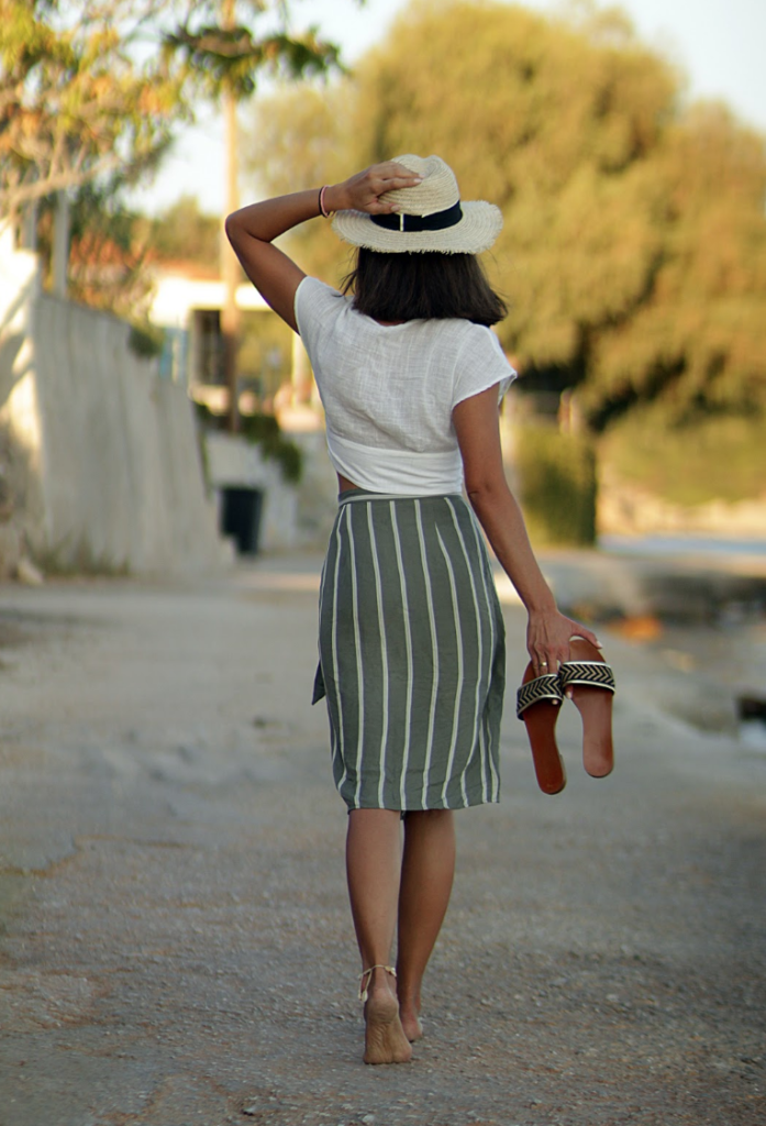 A summer outfit with green skirt and white shirt