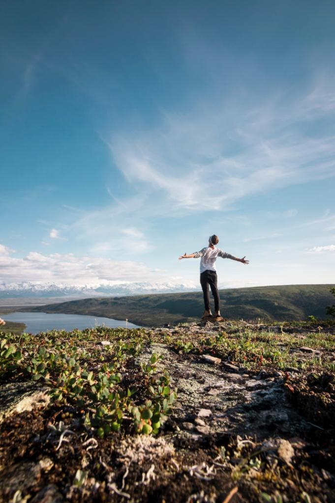 Women standing on cliff in alaska