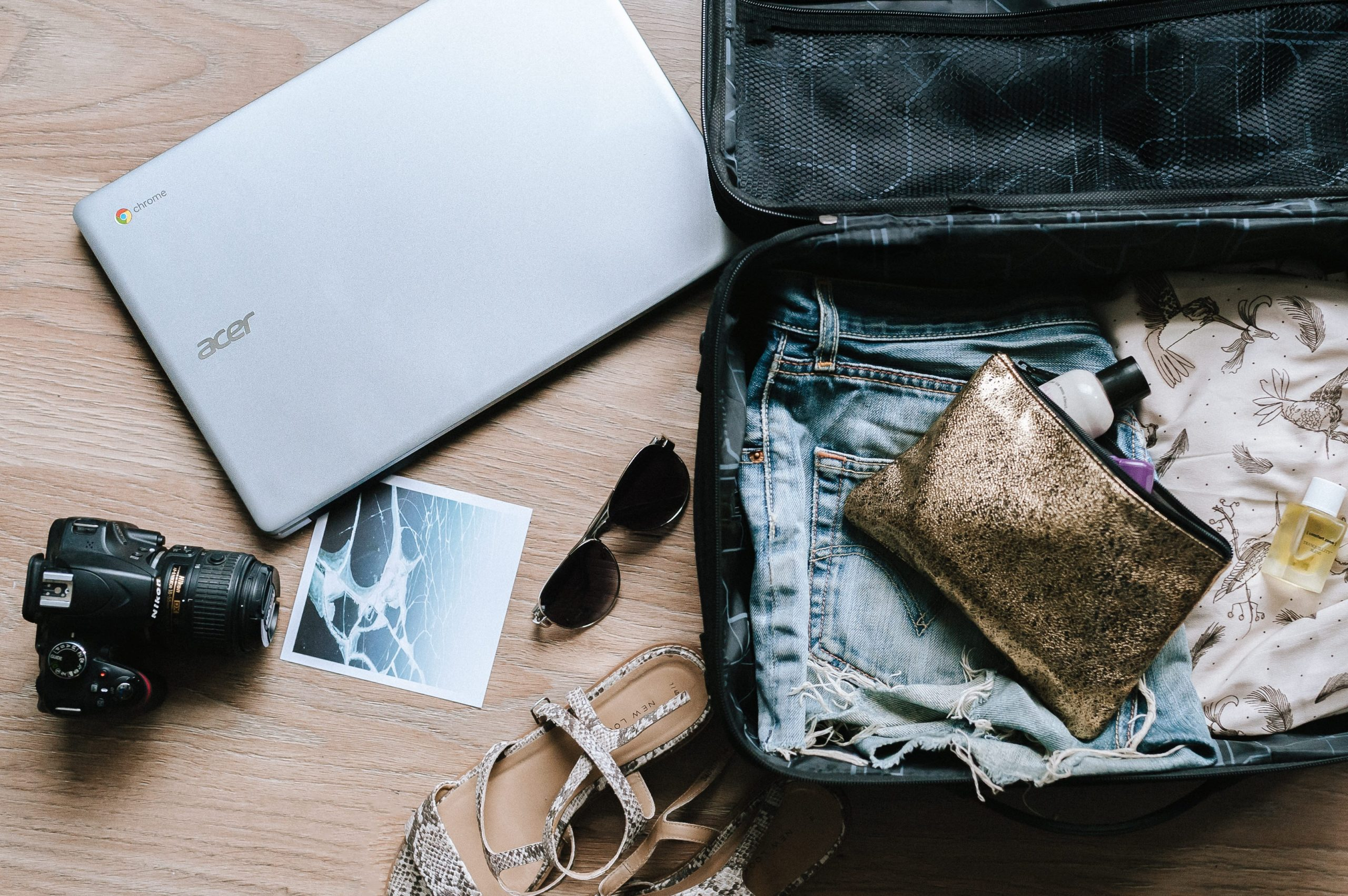 travel essentials packed in a suitcase