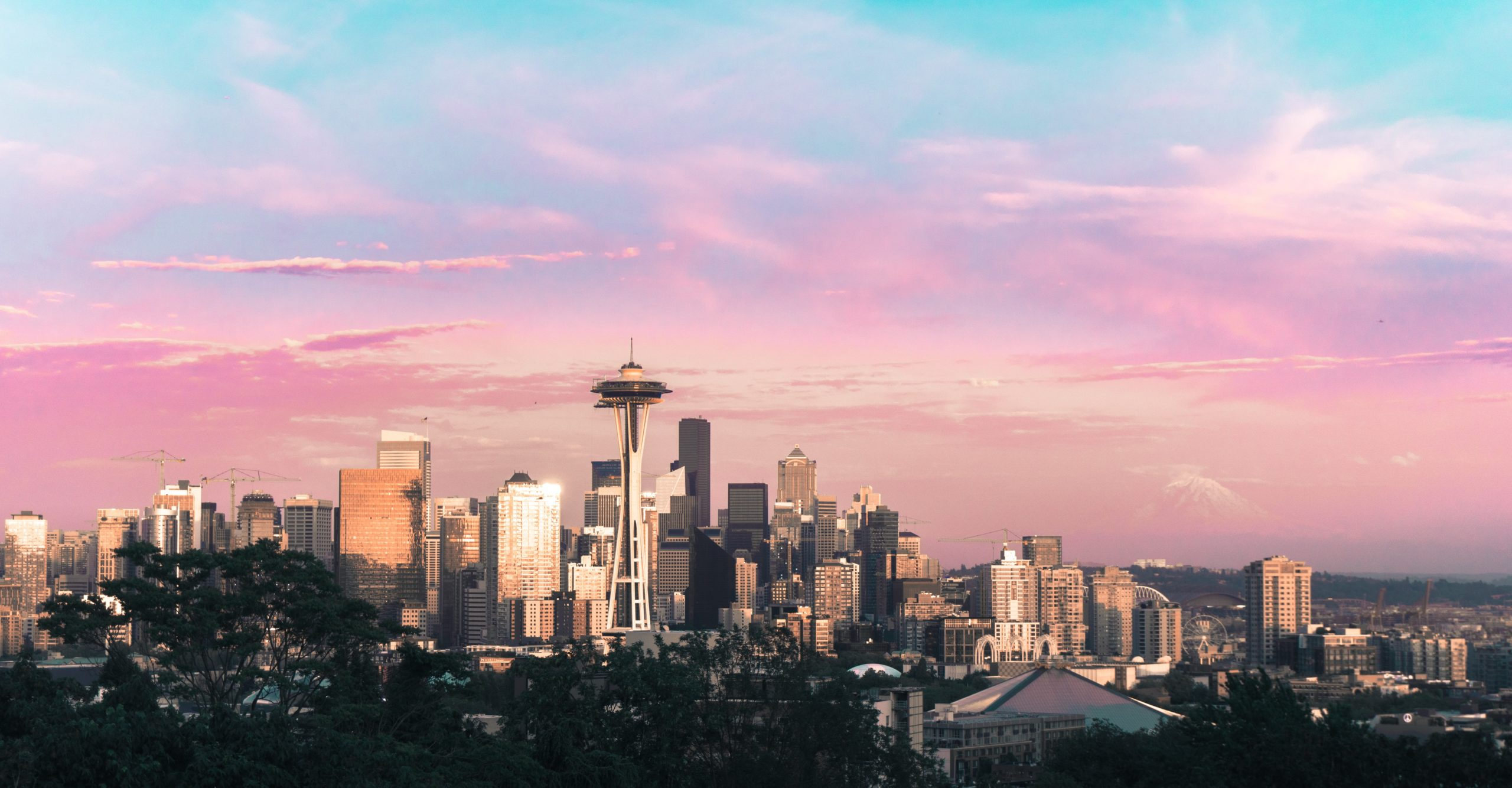 Skyline of Seattle, Washington with Denali in the background and the Space Needle in the foreground.