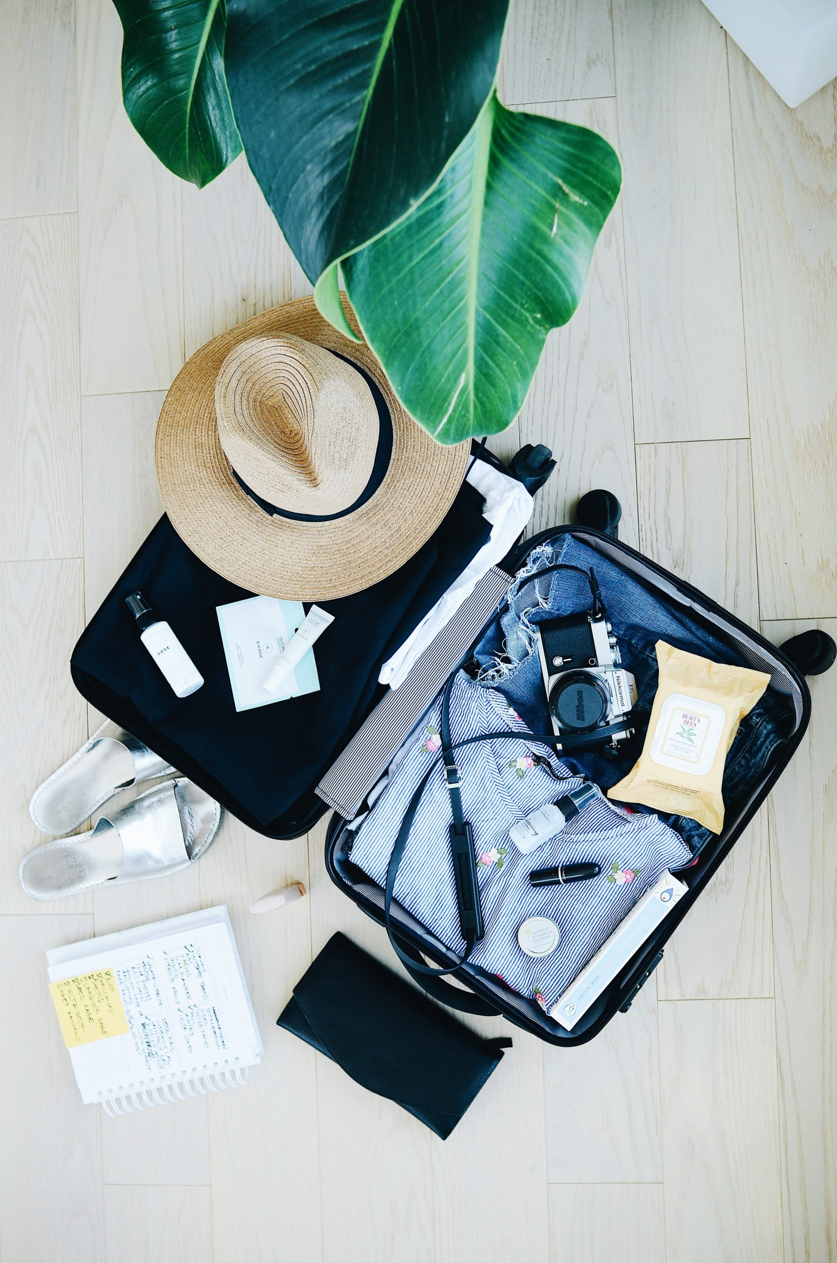 Messy suitcase that could be packed better with travel hacks.