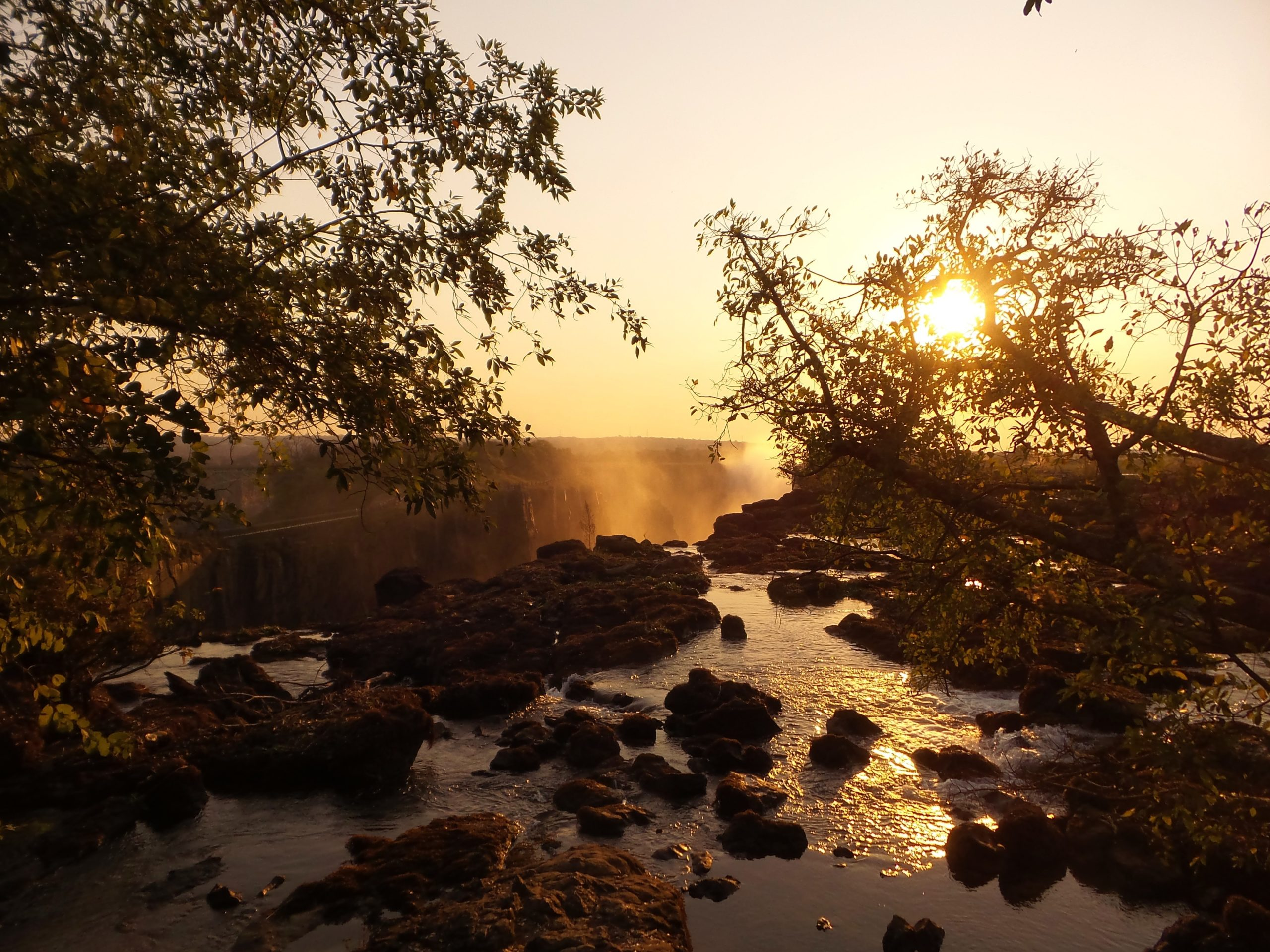 Victoria Falls cascading in the sunset.