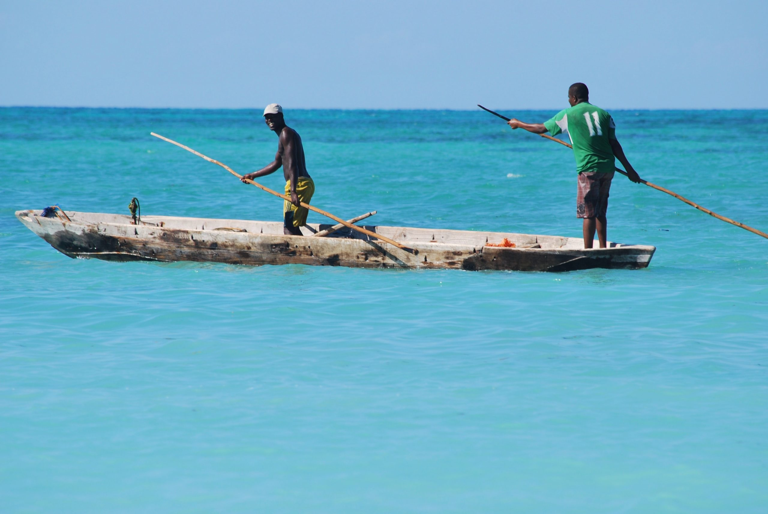 Men fishing in the turquoise waters of Zanzibar.