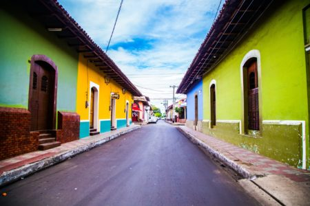Colorful buildings line the streets and are just one of the many things to do in Nicaragua.